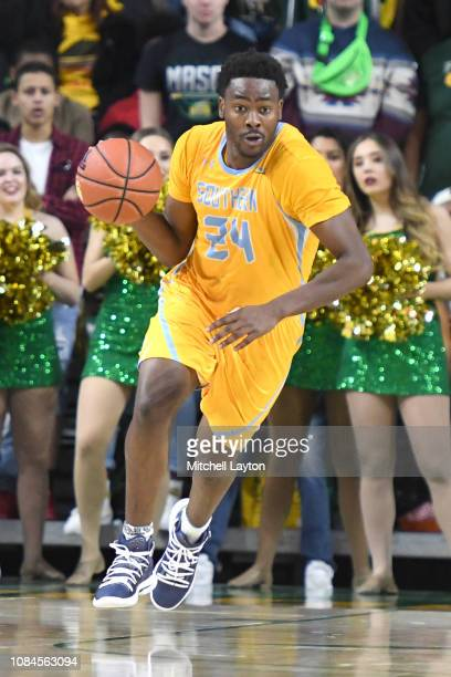 Osa Wilson of the Southern University Jaguars dribbles up court during a college basketball game against the George Mason Patriots at the Eagle Bank...