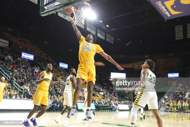 Osa Wilson of the Southern University Jaguars drives to the basket during a college basketball game against the George Mason Patriots at the Eagle...
