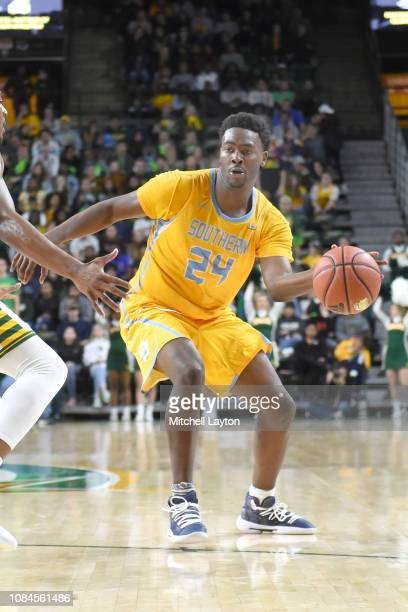 Osa Wilson of the Southern University Jaguars passes the ball during a college basketball game against the George Mason Patriots at the Eagle Bank...
