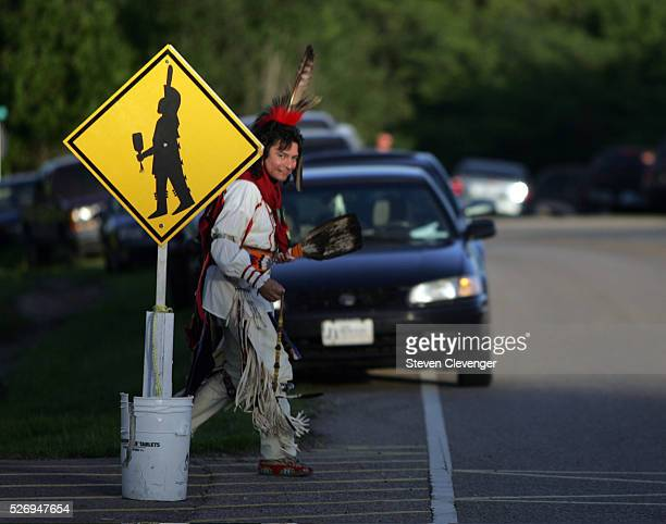 Osage tribal member Kevin Cunnigham of Broken Arrow Oklahoma uses a designated crossing on his way to the location of the annual dances held at...