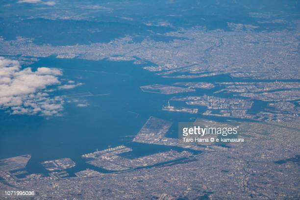Osaka Bay and cityscape in Japan daytime aerial view from airplane