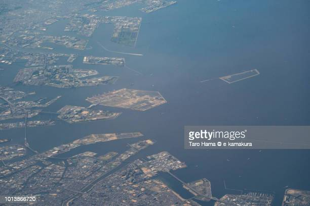 Osaka Bay and Osaka and Amagasaki cities in Japan daytime aerial view from airplane