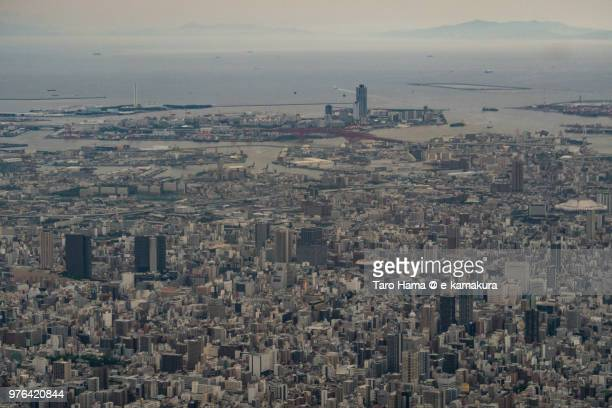 Osaka Bay and Osaka city in Japan daytime aerial view from airplane