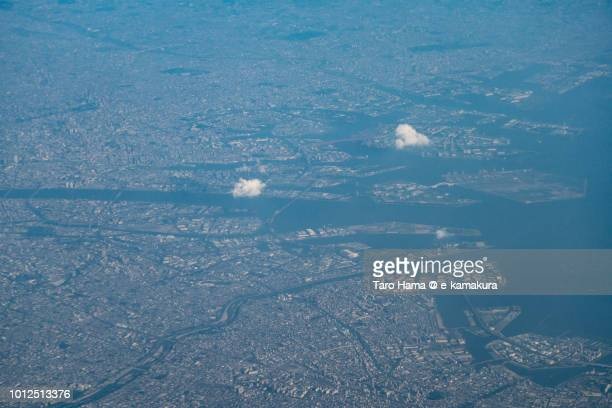 Osaka Bay, Osaka and Toyonaka cities in Osaka prefecture in Japan sunset time aerial view from airplane