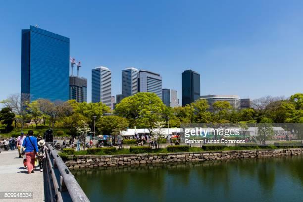 osaka business park as seen from gokurakubashi bridge in the grounds of osaka castle - 大阪ビジネスパーク ストックフォトと画像