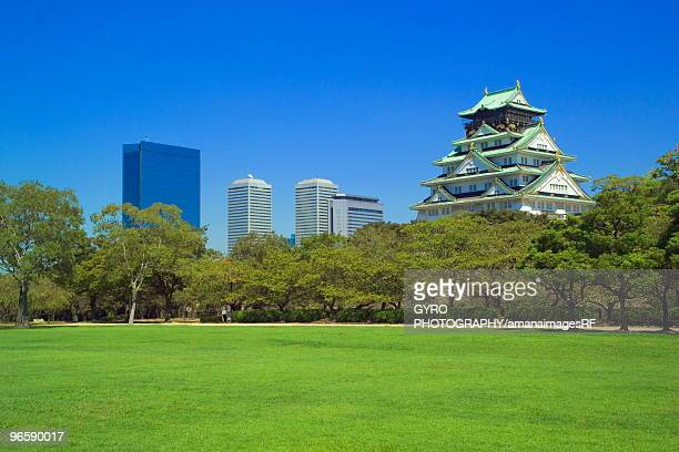 Osaka Castle and office buildings from park, Osaka city, Osaka prefecture, Japan