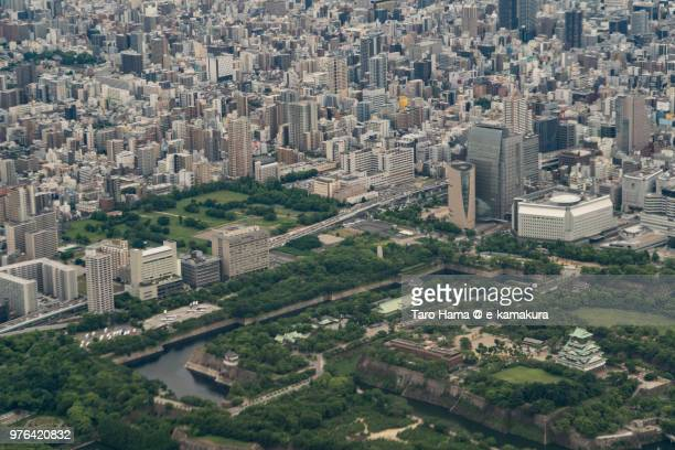 Osaka Castle and Osaka city in Japan daytime aerial view from airplane