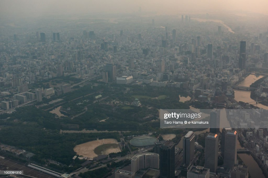 Osaka Castle and Osaka city in Osaka prefecture in Japan sunset time aerial view from airplane : Stock Photo
