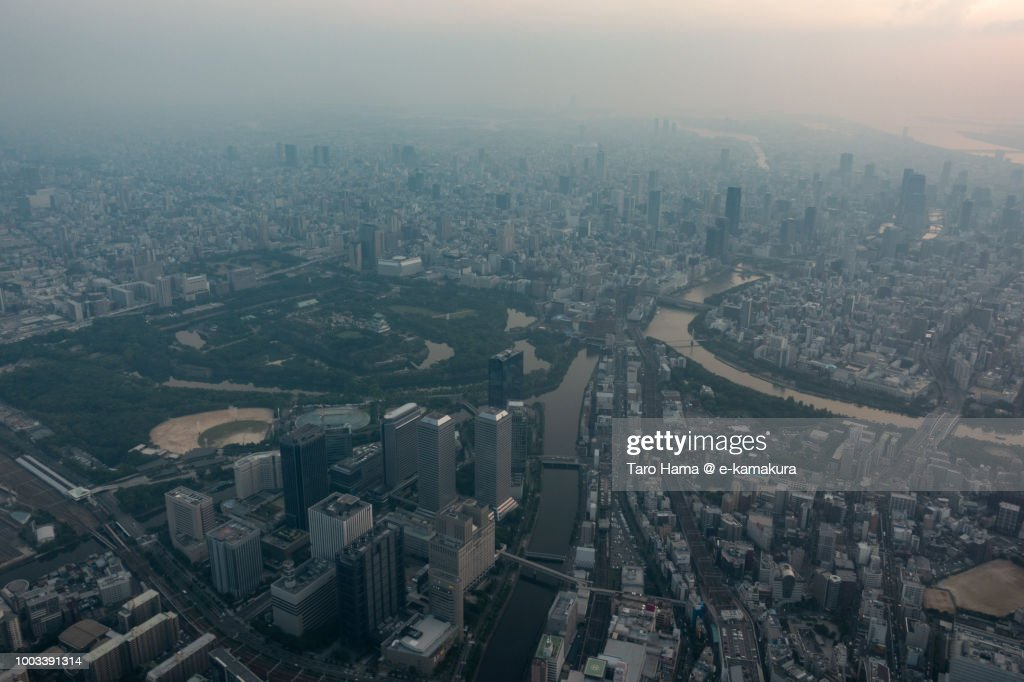 Osaka Castle and Osaka city in Osaka prefecture in Japan sunset time aerial view from airplane : Stock-Foto