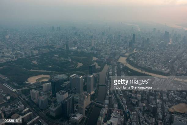 Osaka Castle and Osaka city in Osaka prefecture in Japan sunset time aerial view from airplane