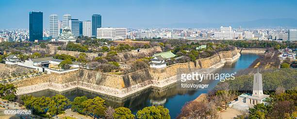 Osaka Castle Park moat battlement overlooked by skyscrapers panorama Japan