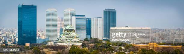 Osaka Castle surrounded by modern skyscraper cityscape panorama Japan