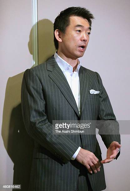 Osaka City mayor and the Japan Innovation Party co leader Toru Hashimoto speaks to media reporters at Osaka City Hall on December 24 2014 in Osaka...