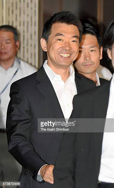 Osaka City Mayor Toru Hashimoto smiles as he arrives at Osaka City Hall a day after defeat of referendum on May 18 2015 in Osaka Japan The final...