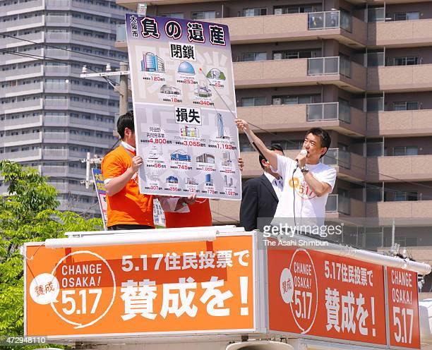 Osaka City Mayor Toru Hashimoto speaks on the street during the referendum campaign on May 10 2015 in Osaka Japan The referendum is on whether to...