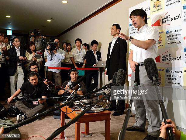 Osaka City mayor Toru Hashimoto speaks to the media after attending the Kansai Electric Power Co annual general shareholders meeting on June 27 2012...
