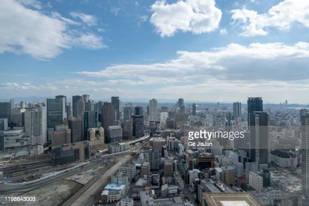 osaka city skyline view - 大阪 ストックフォトと画像