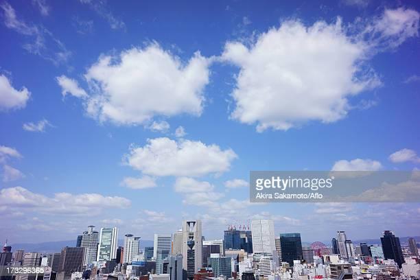 Osaka cityscape and cottony clouds