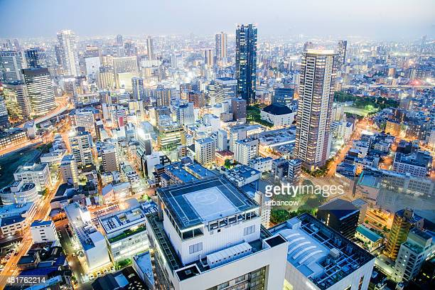 Osaka cityscape at night, illuminated high rise buildings, Japan