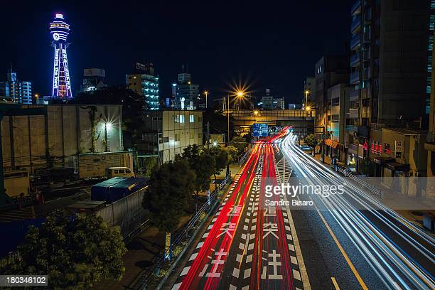 Osaka cityscape at night with traffic trails
