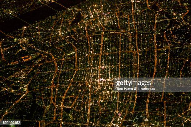 Osaka cityscape, night aerial view from airplane