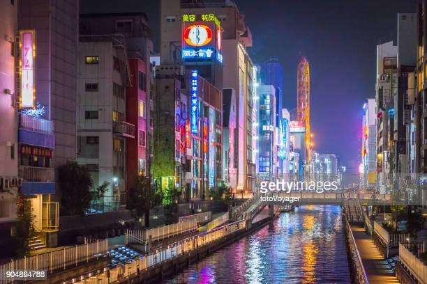 osaka dotonbori canal illuminated neon billboards night city skyline japan - osaka prefecture stock pictures, royalty-free photos & images