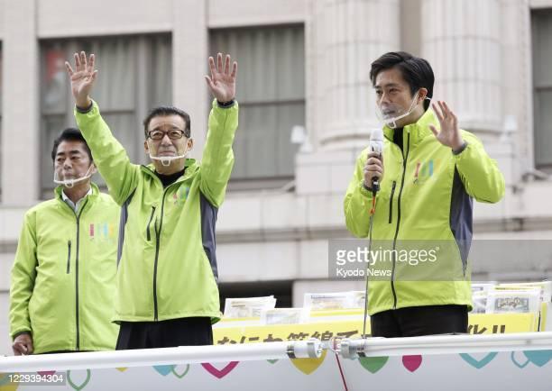 Osaka Gov. Hirofumi Yoshimura , alongside Osaka Mayor Ichiro Matsui , delivers a speech in Osaka on Nov. 1 as a referendum was held the same day on a...