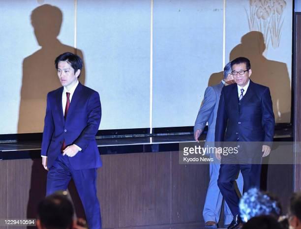 Osaka Gov. Hirofumi Yoshimura and Osaka Mayor Ichiro Matsui arrive at the venue of a press conference in Osaka on Nov. 1 after their plan to...