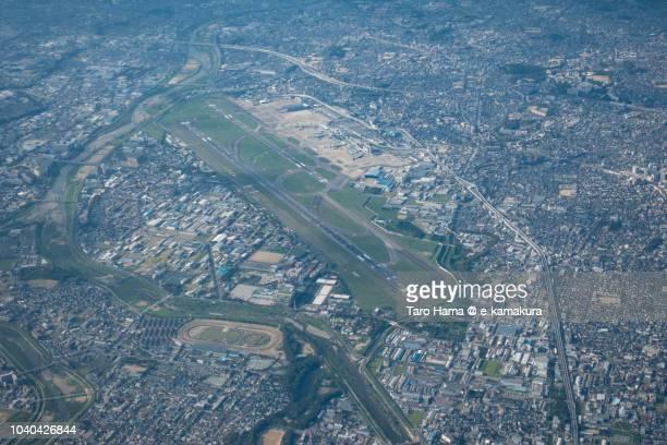 osaka international airport itami (itm) daytime aerial view from airplane - 大阪国際空港 ストックフォトと画像