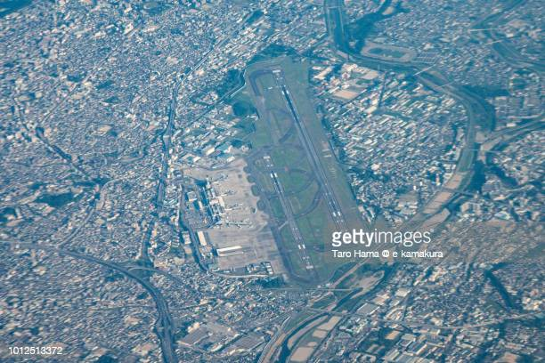 Osaka International Airport Itami in Japan sunset time aerial view from airplane