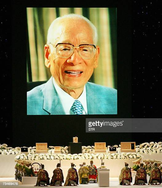 A large portrait of Momofuku Ando inventor of instant noodles is projected during the funeral for Ando who died 05 January at age 96 at the Kyocera...