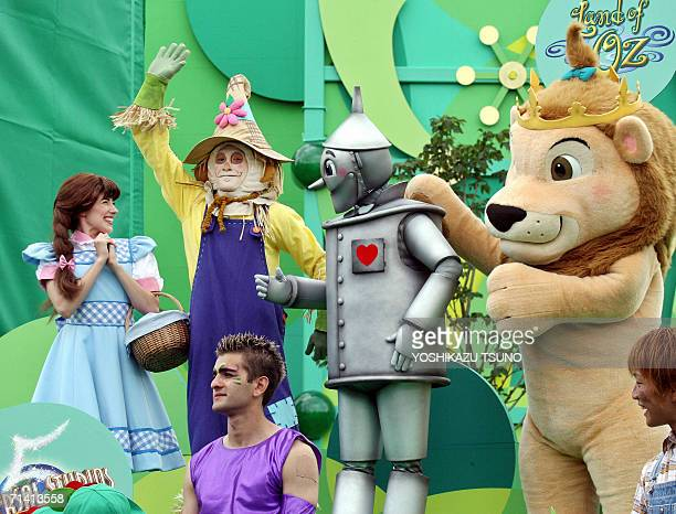 Characters of the Wizard of Oz Dorothy scarecrow tinman and lion greet guests during the new large attraction 'Land of Oz' of the Hollywood theme...