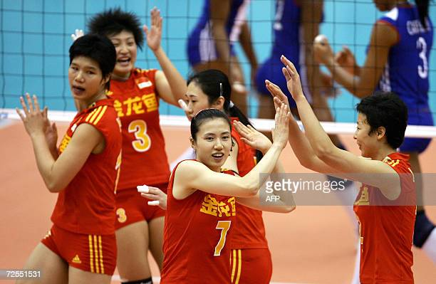 Chinese players celebrate after scoring a point against Cuba during their final round match at the Women's Volleyball World Championships in Osaka,...