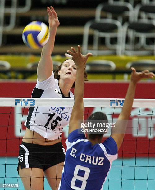 German Angelina Grun spikes the ball past Puerto Rican blocker Eva Cruz during their pool F second round match of the women's volleyball world...