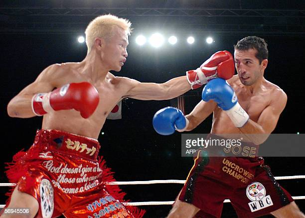 Japanesebased North Korean champion Masamori Tokuyama lands a left on US challenger Jose Navarro at the WBC super flyweight title bout in Osaka 27...