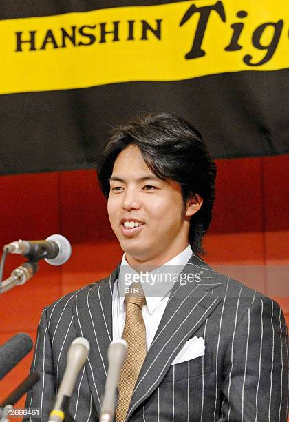 Japan's professional baseball team Hanshin Tigers pitcher Kei Igawa speaks at a press confrence in Osaka western Japan 29 November 2006 a day after...