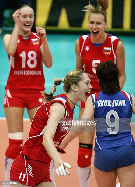 Russia's ace attacker Ekaterina Gamova celebrates with teammates Marina Akulova Lioubov Shanshkova Svetlana Kryuchkova after winning the women's...
