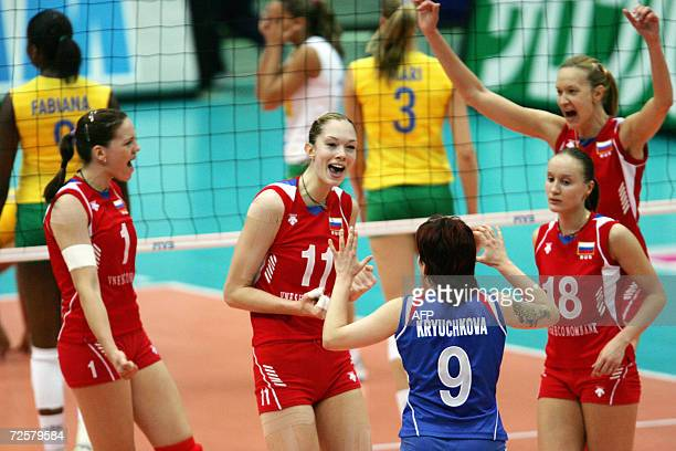 Russia's players celebrate during the women's final match against Brazil in the Volleyball World Championships in Osaka western Japan 16 November...