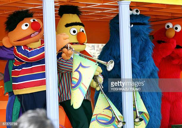 7eb58be40c Sesame Street characters Earnie Bert and Cookei Monster trumpets with  figure five to celebrate the fifth