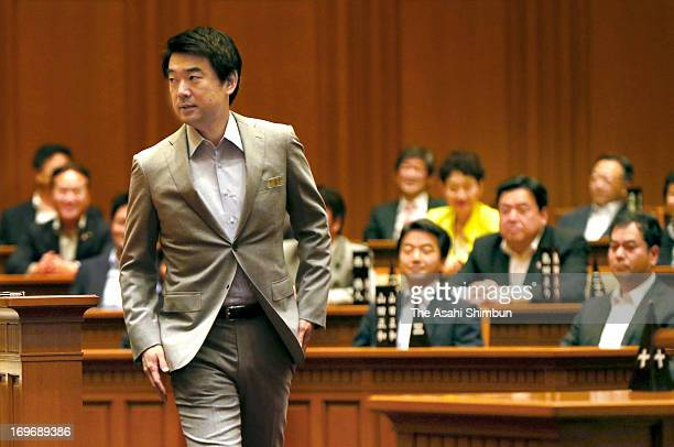 Osaka mayor Toru Hashimoto enters the Osaka city assembly hall at Osaka City Hall on May 30 2013 in Osaka Japan The assembly handed the motion...