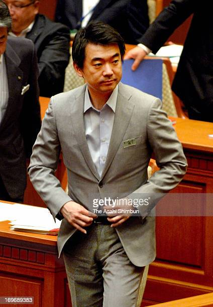 Osaka mayor Toru Hashimoto leaves the assembly hall after Osaka city assembly rejected the censure motion against Hashimoto at Osaka City Hall on May...