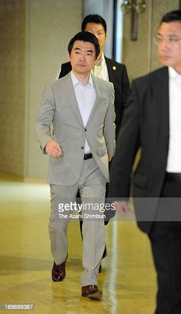 Osaka mayor Toru Hashimoto walks a corridor before Osaka city assembly rejected the censure motion against Hashimoto at Osaka City Hall on May 30...