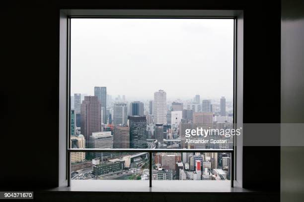 osaka skyline seen through square window - 窓 ストックフォトと画像