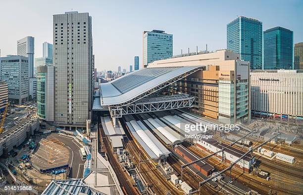 osaka station rail tracks platforms and skyscrapers umeda japan - osaka prefecture stock pictures, royalty-free photos & images