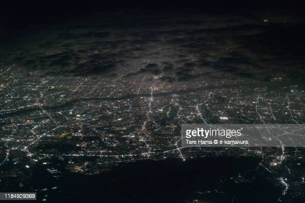 osaka, toyonaka and suita cities in osaka prefecture of japan aerial view from airplane - taro hama ストックフォトと画像