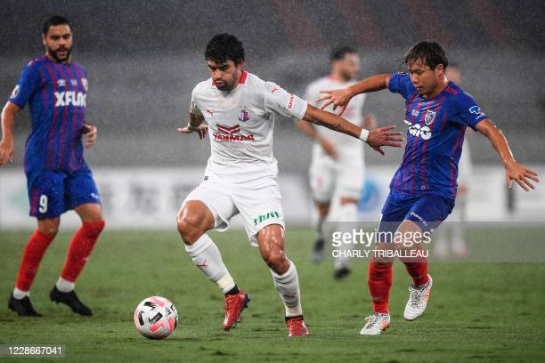Osaka's Brazilian forward Bruno Mendes fights for the ball with Tokyo's midfielder Shuto Abe during the J-League football match between FC Tokyo and...
