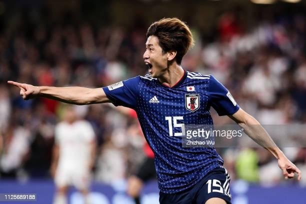 Osako Yuya of Japan celebrates his scoring with teammates during the AFC Asian Cup semi final match between Iran and Japan at Hazza Bin Zayed Stadium...