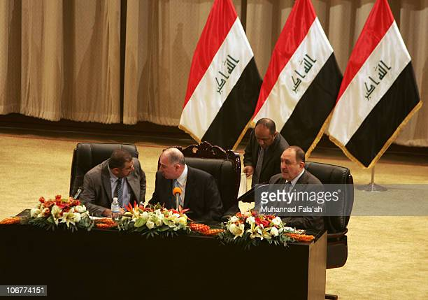 Osama alNujaifi the newly elected speaker of the Iraqi Parliament speaks with his deputies after a voting session on November 11 2010 in the Green...