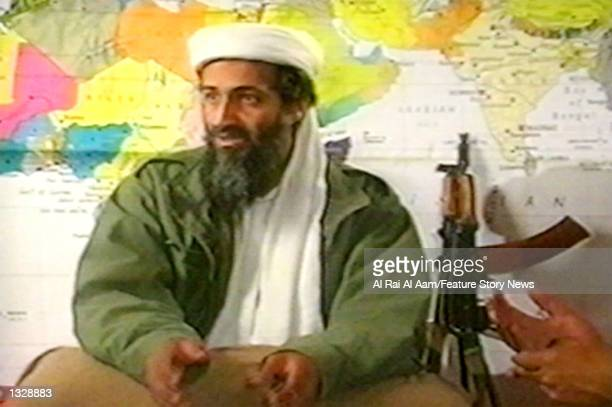 Osama bin Laden sits in front of a map in this undated still frame from a recruitment video for his extremist AlQaida network