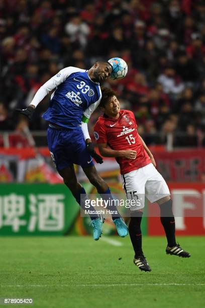 Osama Hawsawi of AlHilal and Kazuki Nagasawa of Urawa Red Diamonds compete for the ball during the AFC Champions League Final second leg match...